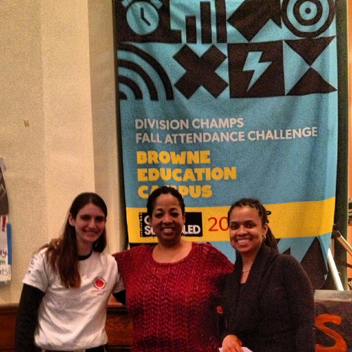 City Year Program Manager Kristen McDonough, TDS School Transformation Facilitator Anise Walker and Interim Principal Naimah Salahuddin with the championship banner
